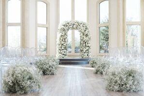 Lush Aisle Decor With Floral Wedding Arch