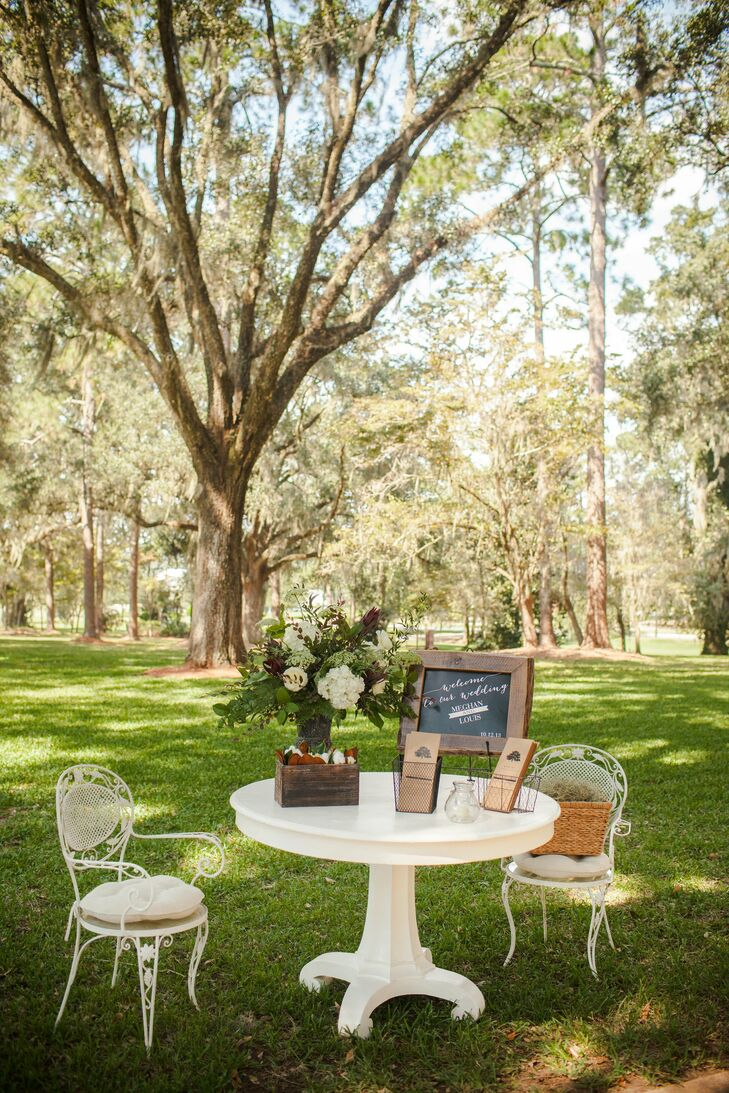 A vintage table and chairs greeted guests at the entrance to the ceremony and provided the ideal spot everyone to grab a program.