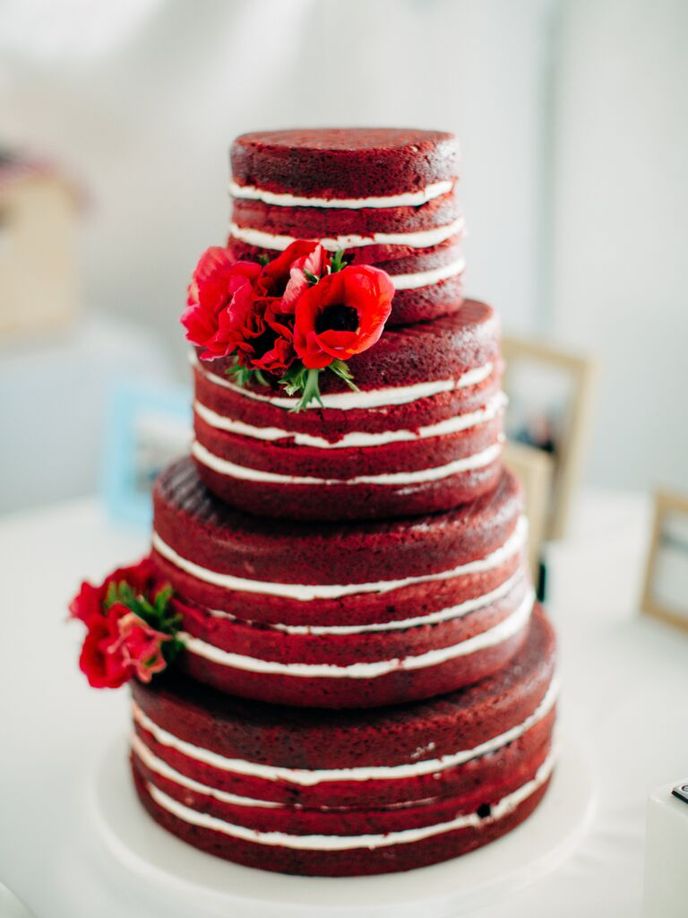 Naked Four Tiered Red Velvet Cake With White Icing and Poppies