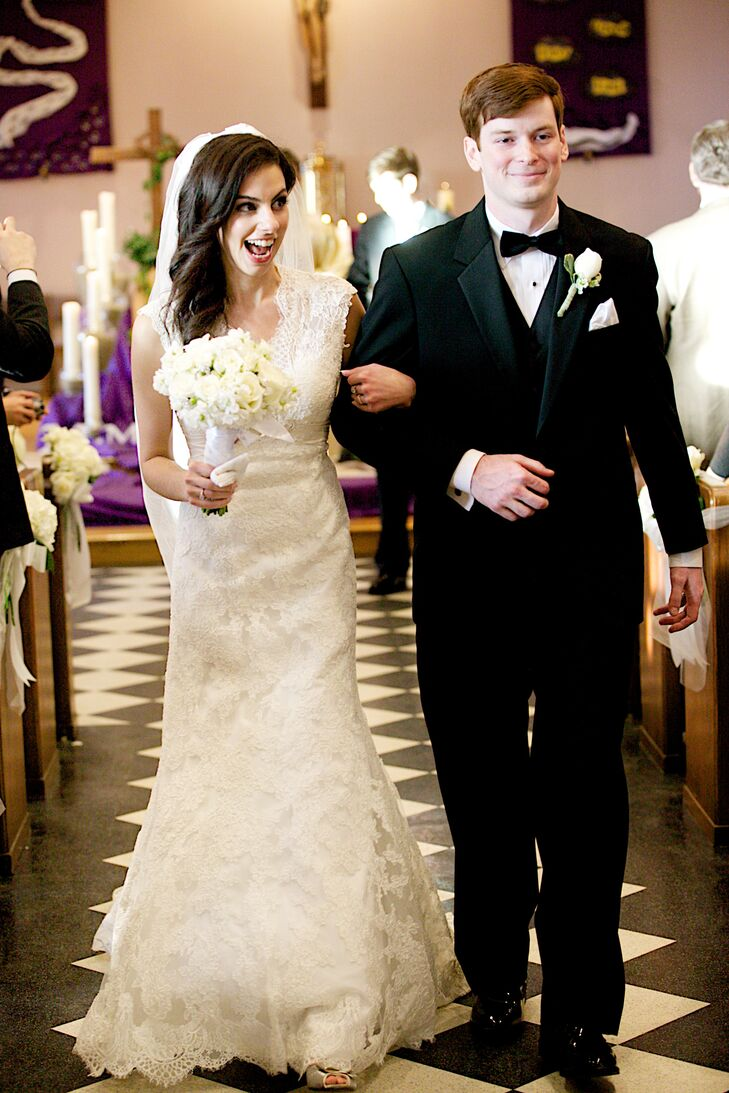 """Jessica wore a lace trumpet gown with cap sleeves. """"My goal was to have a timeless and traditional look,"""" she says. """"The back of my dress had a key hole and added a modern twist."""""""