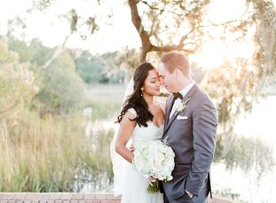 """<b style=""""font-weight: normal;"""">Gladys Velasquez (28 and a resident physician) and Tony Clarke (34 and an account manager) exchanged vows at the ocean"""