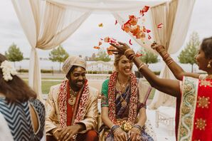 Flower Petals Tossed on Couple During Hindu Wedding Ceremony