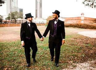 """For their wedding at Fort Conde Inn in Mobile, Alabama, Jaron and Brian planned a glitz-and-glam-filled wedding inspired by Mardi Gras and rainbows. """""""