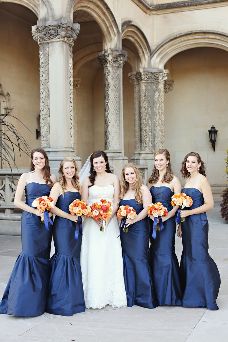 """""""My bridesmaids tried on this gorgeous sample dress and how it fit all of them I have no idea considering they're all completely different heights—it was like the sisterhood of the traveling dress,"""" says Kathryn. """"We went with the navy blue Monique Lhuillier dress that literally looked dropped dead gorgeous on all of them—I wish I had one myself!"""""""