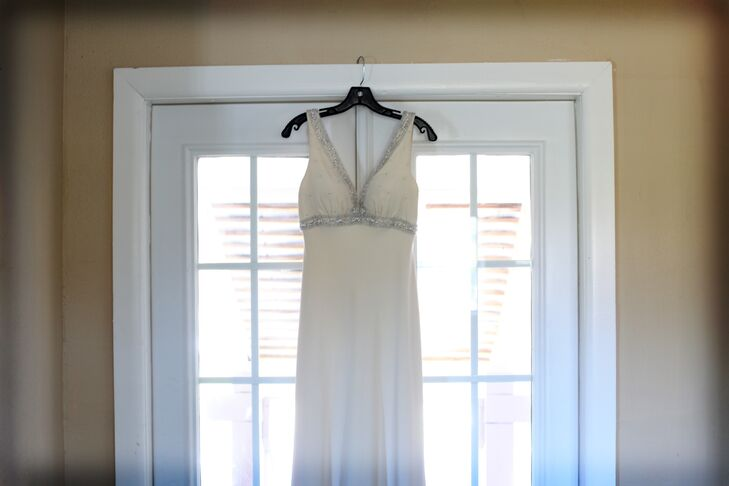 For her waterfront wedding, Melissa wore a silk sheath wedding dress with beading in the bodice.