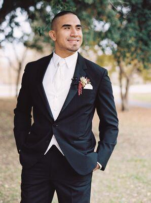 Elegant Black Suit With White Tie