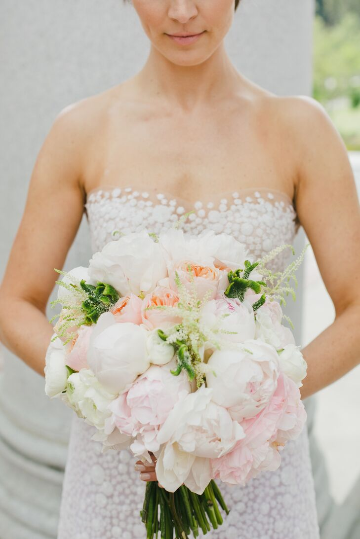 """Petals LA created the event's delicate blush pink florals. """"Each floral arrangement was different, with a mash-up of mauve roses and peach tulips, with peonies, Juliet roses and Queen Anne's lace,"""" Shannon says."""