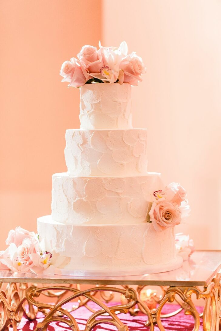 Elegant Tiered Wedding Cake with Pink Flowers