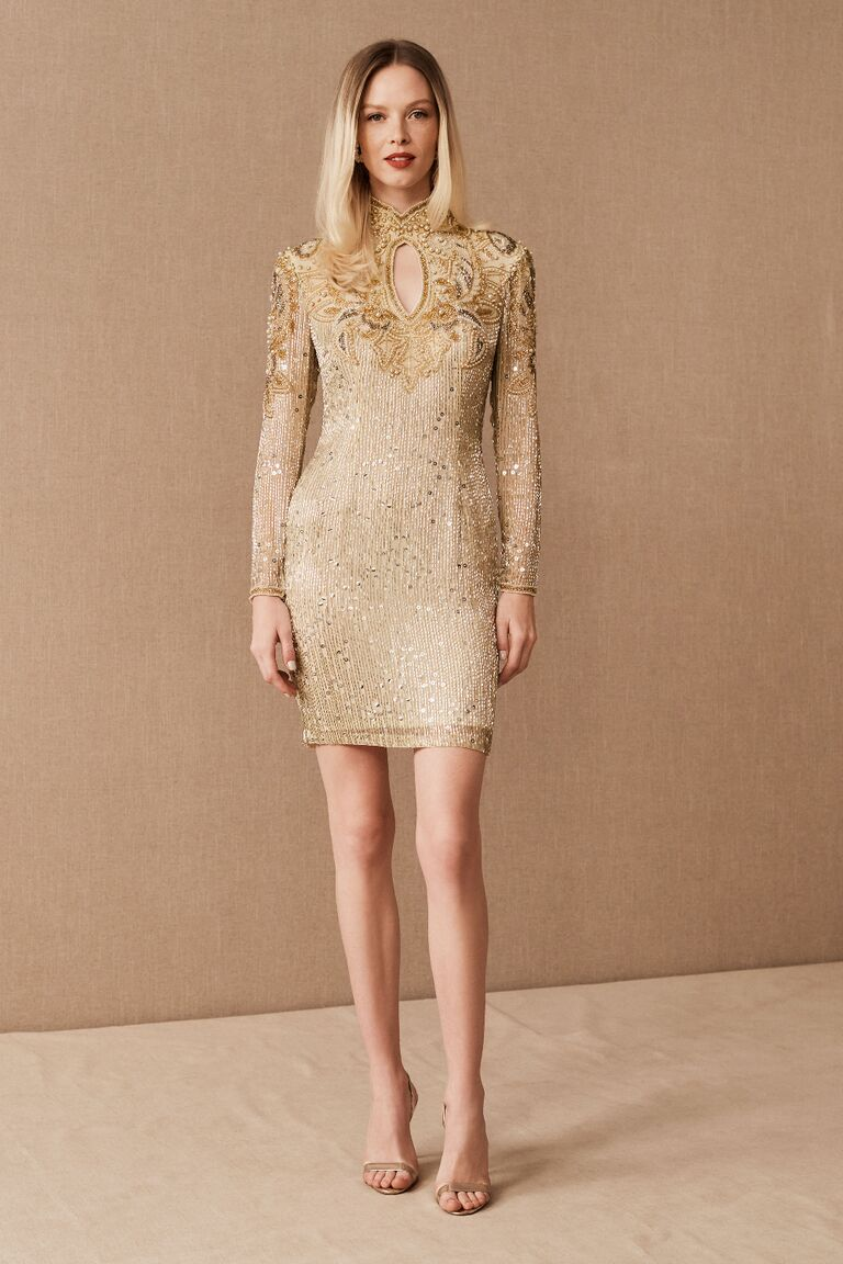 Vintage long sleeve mini dress with gold and pearl beading and keyhole cutout