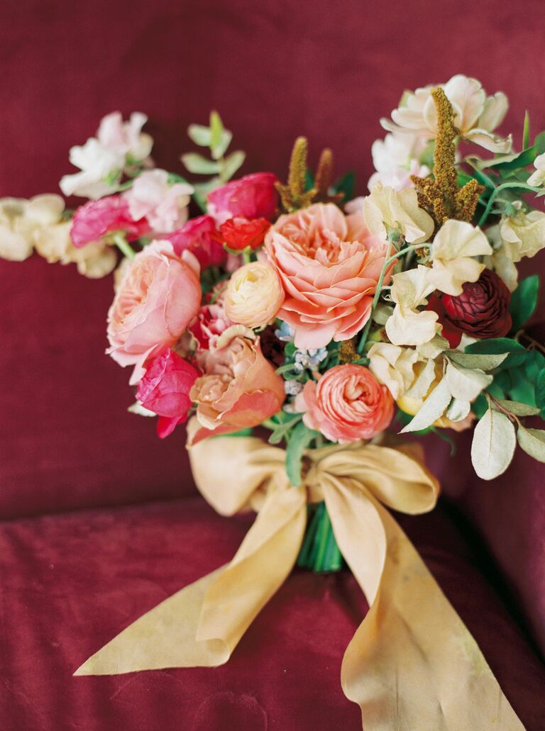 Peach-hued bouquet with yellow ribbon