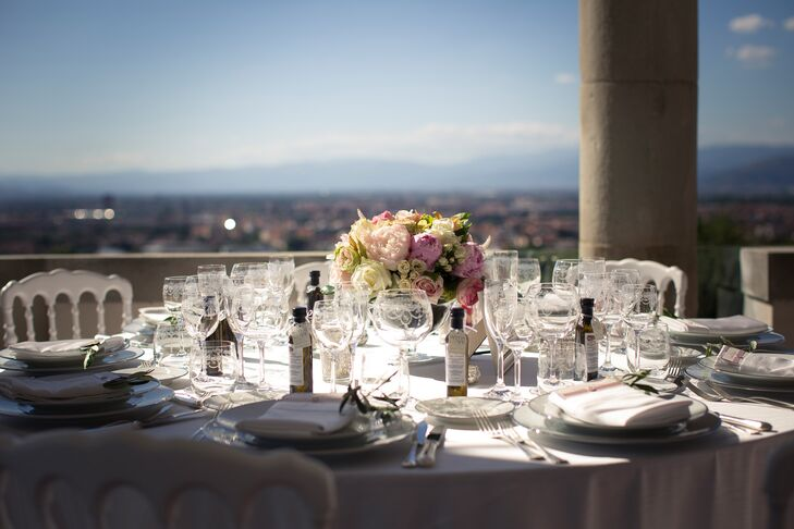 The reception took place on the terrace and loggia at Villa Tolomei Hotel in Florence, Italy. The space featured stunning views of the surrounding Italian countryside.
