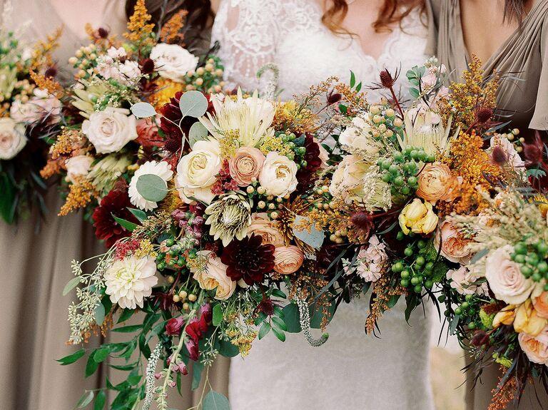 rustic fall wedding bouquet with roses, ranunculus, dahlias,