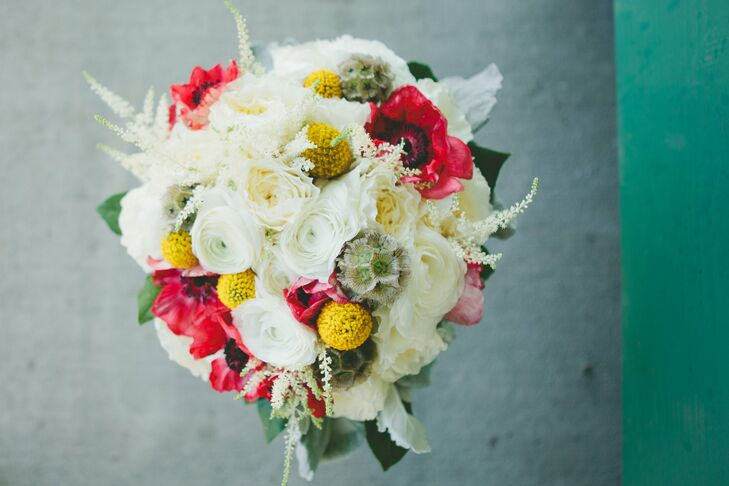 White ranunculas and cabbage roses filled Megan's bridal bouquet. Red anemones and yellow billy ball added pops of color while astilbe and scabiosa pods gave a rustic edge to the eclectic floral mix.