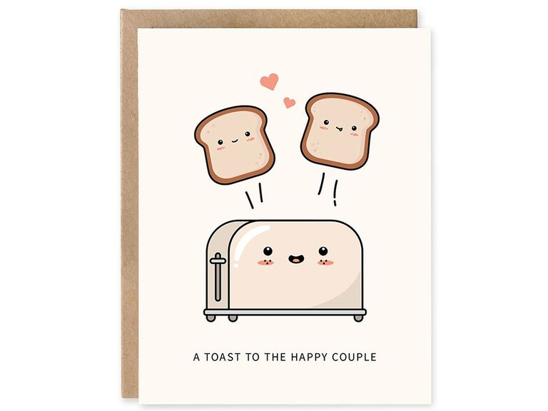 'A toast to the happy couple' in black minimalist type with cuter toaster and toast pieces graphics on light blush background