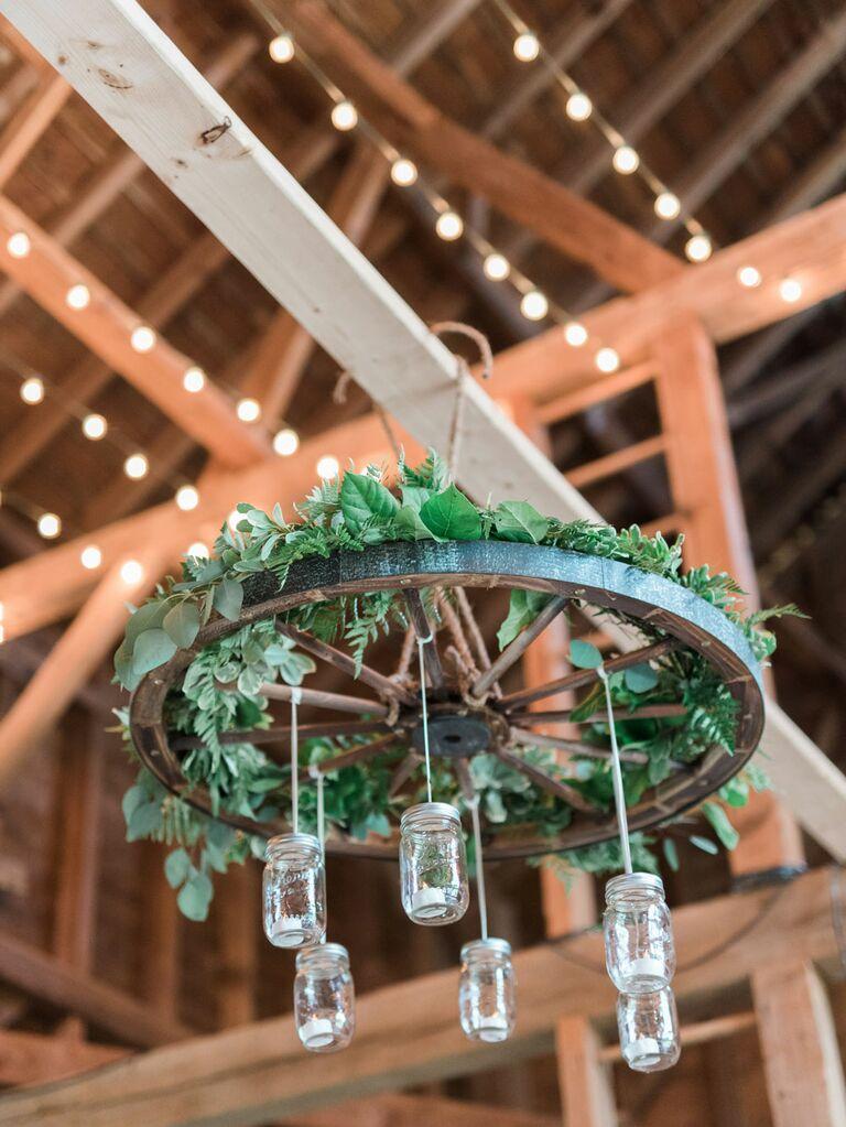 Mason jars hanging from ceiling of rustic barn wedding venue