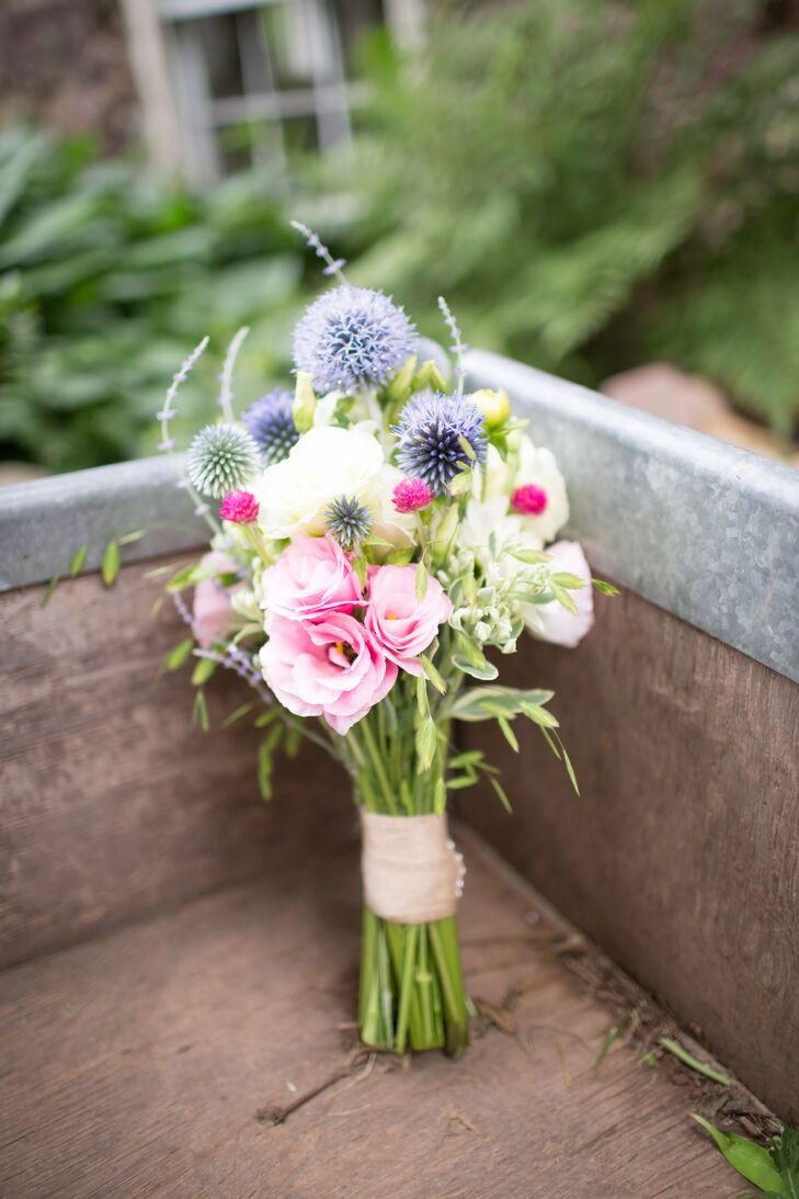 All of the day's flowers—including Ali's pink rose and thistle bouquet— were all grown on the farm and lovingly arranged by their friends and family.