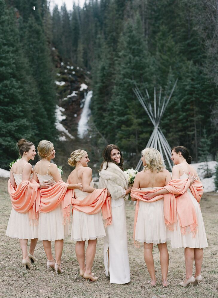 The bridesmaids wore champagne dresses from J. Crew. Karine gave each bridesmaid a peach pashmina to stay warm in the cold weather.