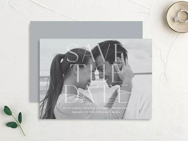 Grayscale personalized photo background with 'Save the Date' in minimalist white type