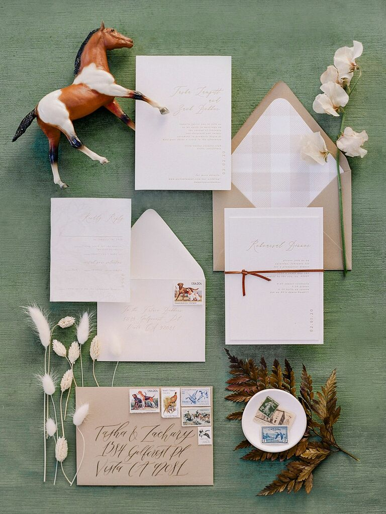 Country-themed wedding invitation flatlay with horse motif and dried florals