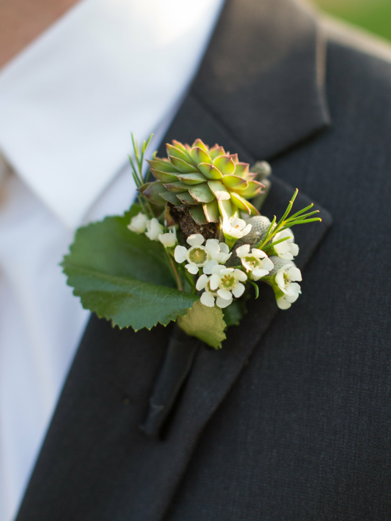 Boutonniere with wax flowers and succulents