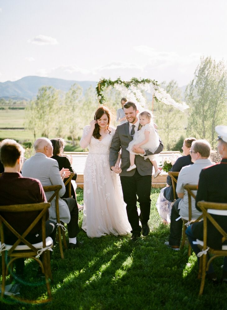 Recessional with Bride, Groom, and Child in Colorado Mountains