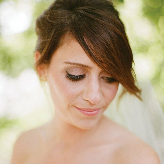 Sarah wore her hair in a romantic, loose updo accented with a long veil.