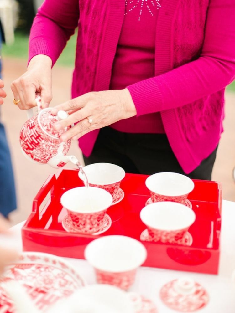 person pouring tea during Chinese tea ceremony