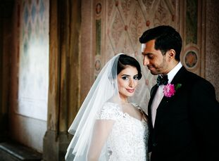 """Mneera (28) and Abdulla's (27 and a Columbia Business School student) whimsical wedding was inspired by Alice in Wonderland. """"I love all the Disney fa"""
