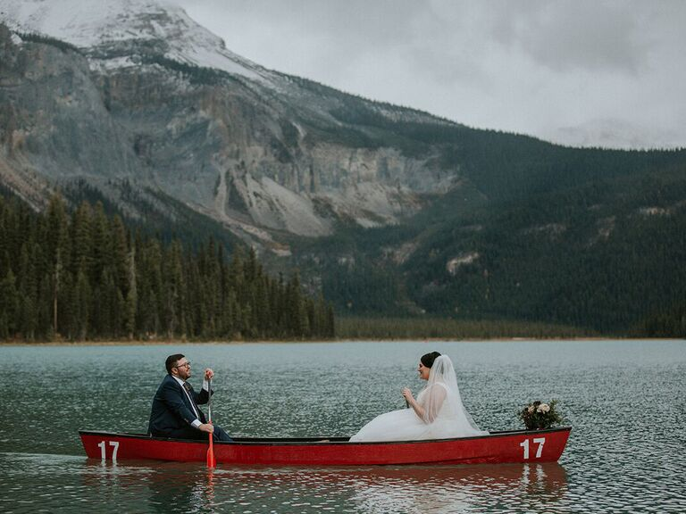 Couple smiling in row boat