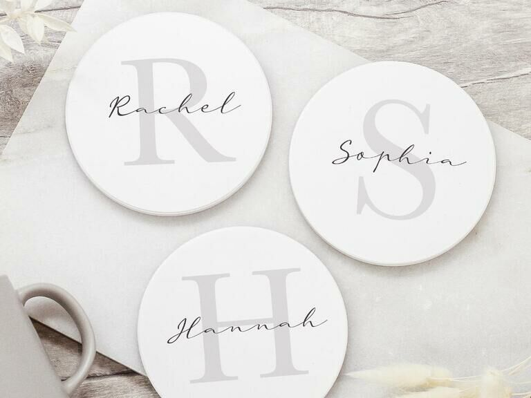 Three personalized ceramic coasters with different names and monograms