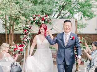 The vibrant, candy-apple red color palette Kayleigh and Vince chose for their wedding was fitting for multiple reasons. Including red in the wedding a