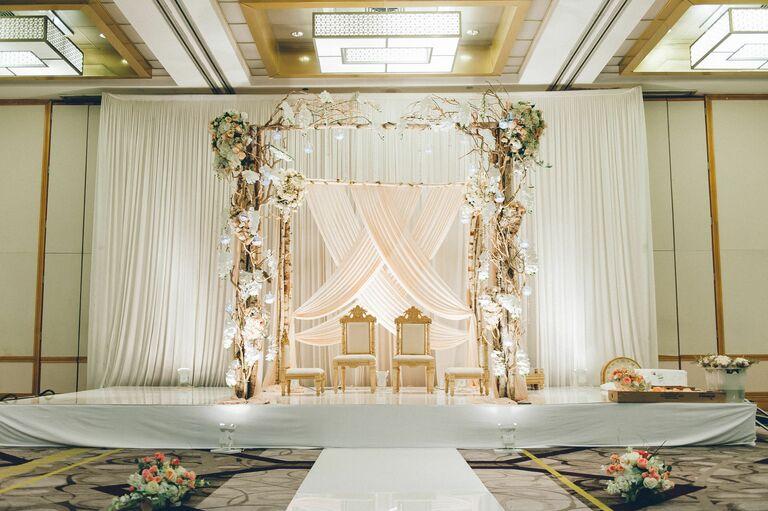 All-white mandap in hotel ballroom