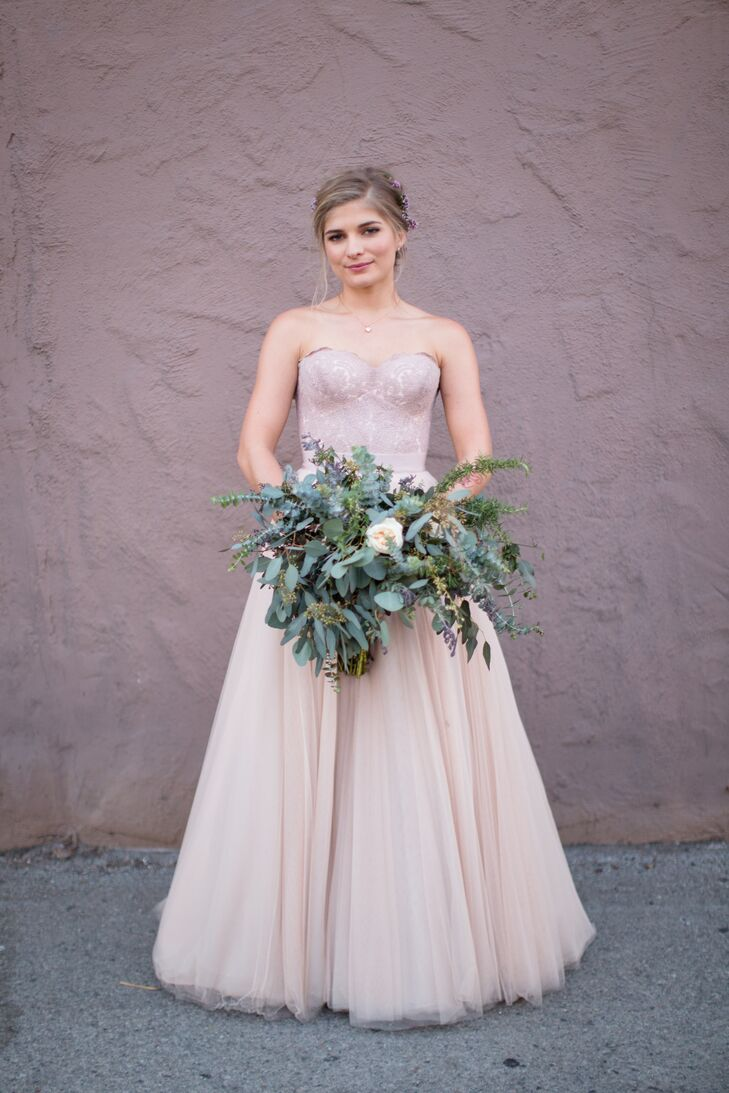 """Alexandra's Watters dress blended contemporary style with classic elegance. """"It had a sweetheart corset with a skirt that was made up of layers and layers of this incredibly soft tulle,"""" says Alexandra, who paired it with a lush bouquet of eucalyptus, succulents and dahlias. """"I wanted something with impact but nontraditional, and I got exactly that."""""""