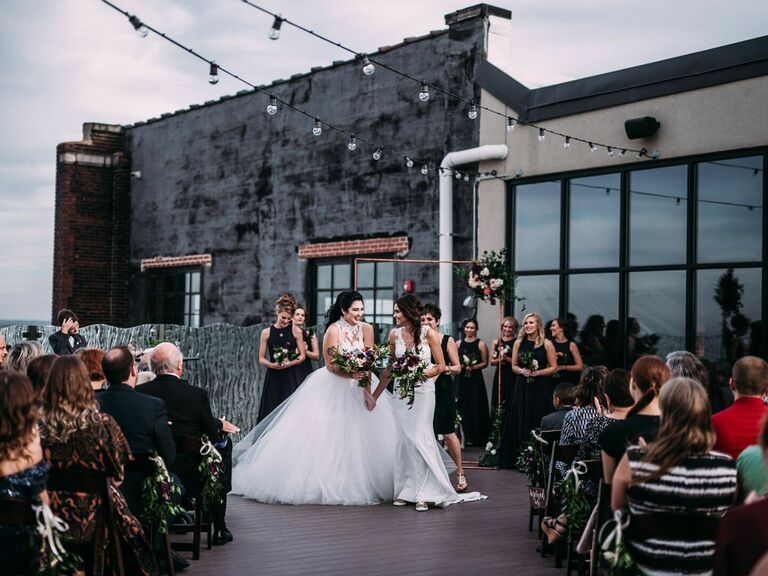 Brides at modern/industrial-themed rooftop wedding