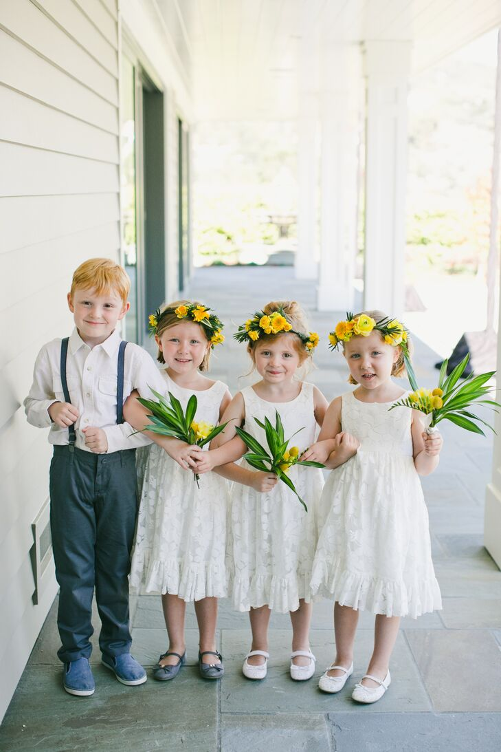 """Flower girls wore simple white dresses and yellow flower crowns. """"The flower girls requested dresses that they could twirl in, which we gladly obliged,"""" Carolyn says."""