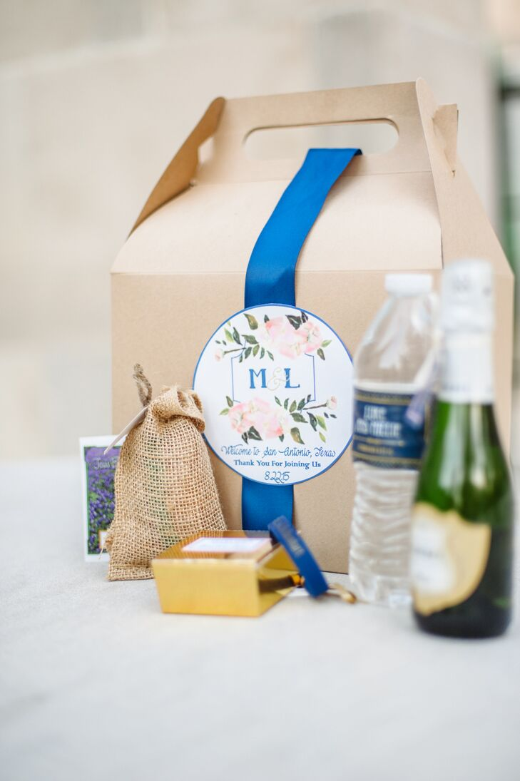 Guests were given natural brown boxes, including water bottles, mini bottles of champagne and a few other postwedding necessities as they exited the reception. The boxes were tied shut with a bright blue ribbon and adorned with a sticker that included the couple's monogram.