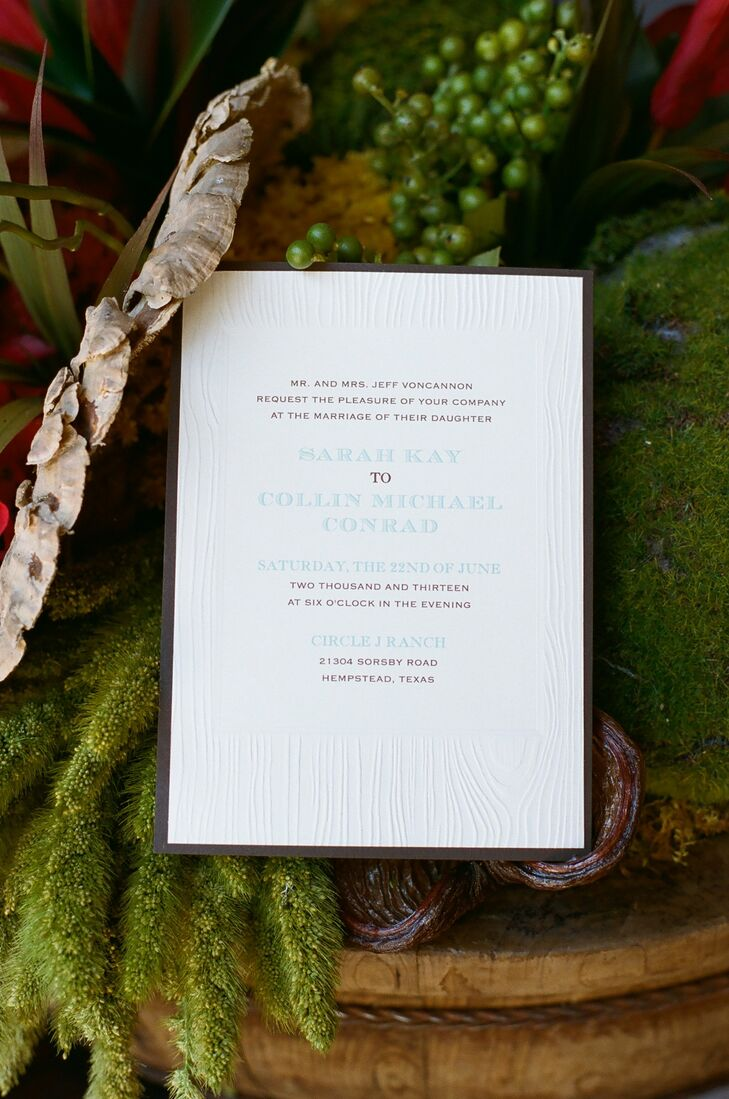 The simple invitations were given a subtle woodland vibe with an embossed wood grain texture.