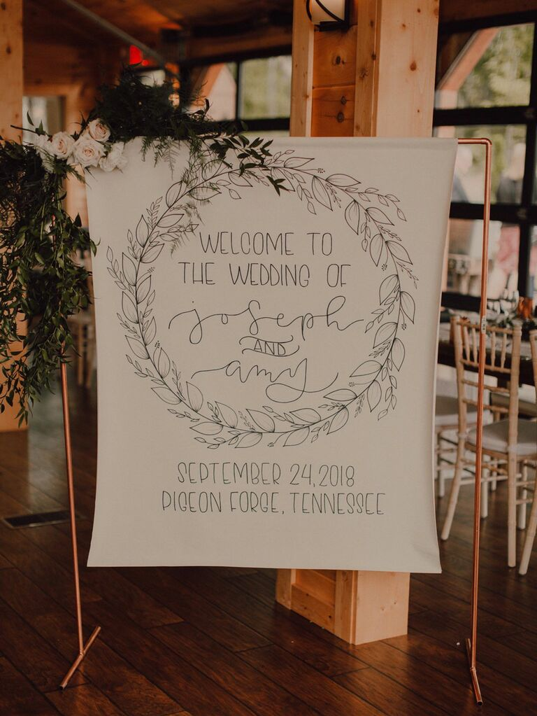 Hanging canvas wedding welcome sign