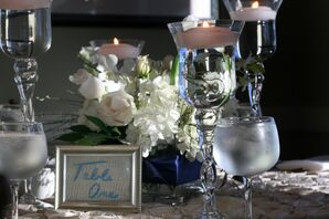 White Floral Centerpiece and Floating Candles