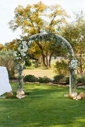 Outdoor Wedding Arch Draped with Hydrangeas, Roses and Greenery