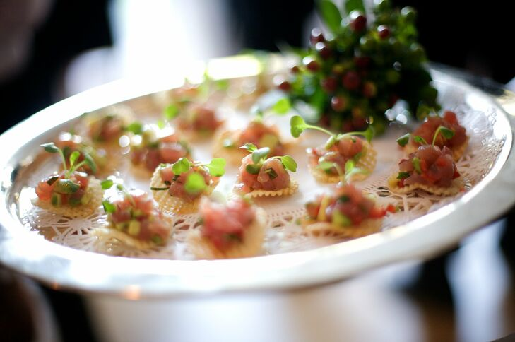Guests snacked on an assortment of passed hors d'oeuvres like yellowtail tuna tartare bites with fresno chiles and arugula on potato gaufrettes.