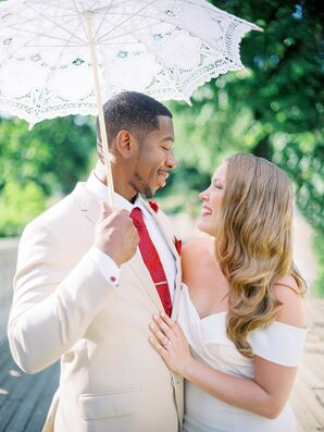 Couple Posing Under Parasol During Elopement in Central Park