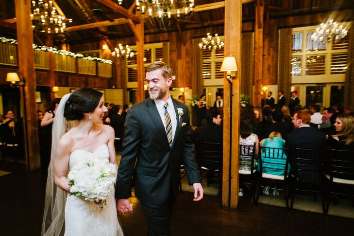 """The Vitamin String Quartet provided the soundtrack for the ceremony. """"Say Yes"""" by Elliot Smith and Coldplay's """"Yellow"""" accompanied Justin and the couple's wedding party down the aisle, while Kim made her entrance to Eric Clapton's """"Wonderful Tonight."""" Kim and Justin exited the ceremony as newlyweds to """"I'm Yours"""" by Jason Mraz and ushered guests to The Barn's heated deck for cocktail hour."""
