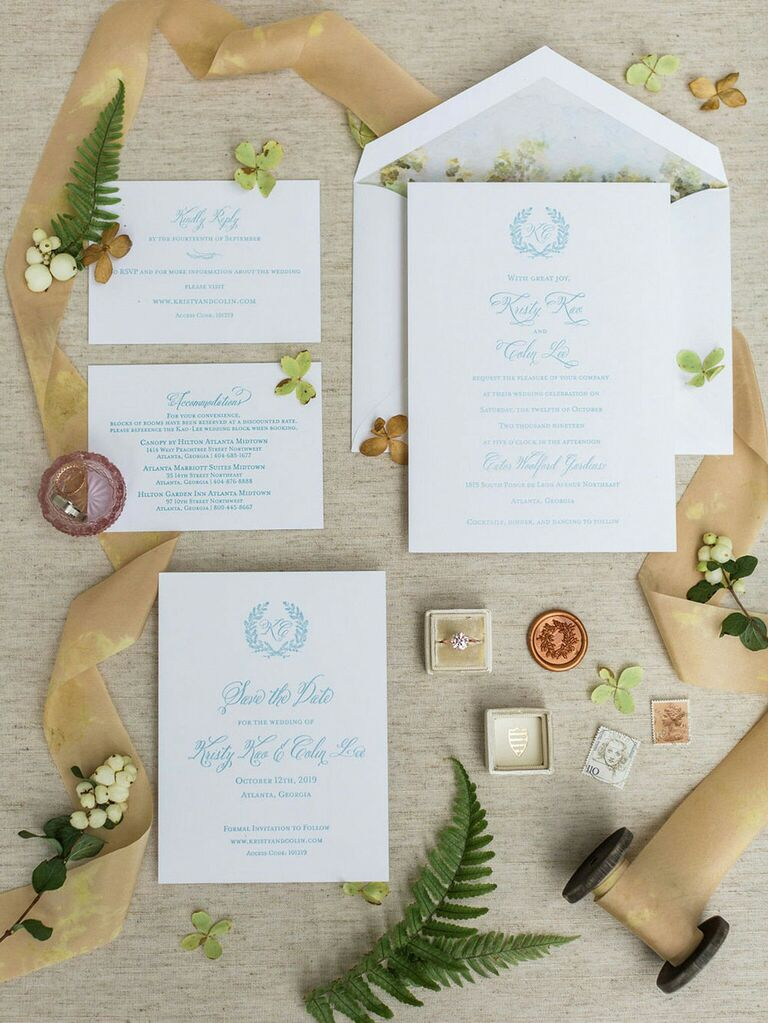 Cottagecore wedding invitation suite with ribbon and floral accents