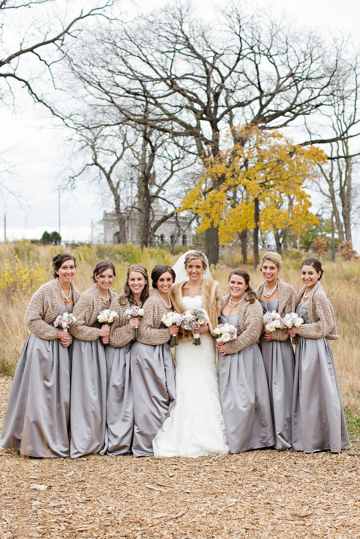 Each of Amanda's seven bridesmaids wore satin A-line dresses in a shade that can best be described as silver meets lavender.