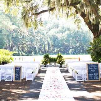 Aisle runner outdoor elegant wedding under moss trees