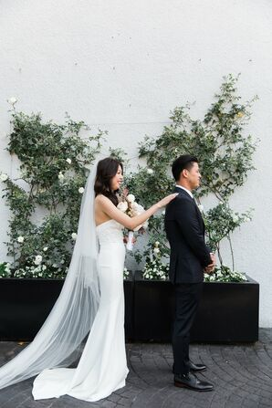Traditional First Look with Greenery Arrangement Backdrop
