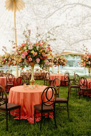 Tented Wedding Reception With Tall Centerpieces and Orange Linens
