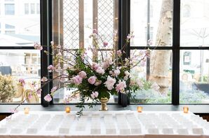 Escort Card Table with Pink Peony and Cherry Blossom Arrangement
