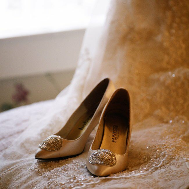 Elizabeth's satin shoes were the perfect accent to her lace gown.